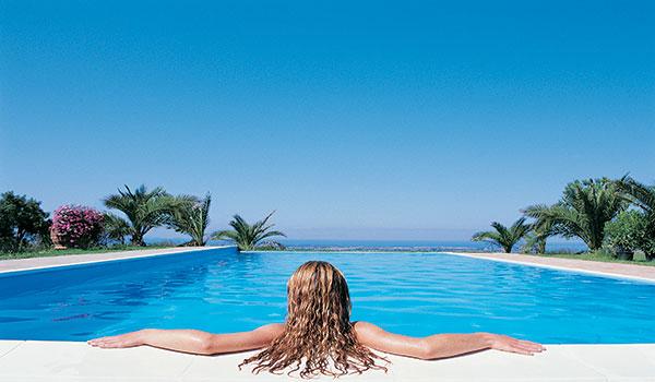 women-relaxing-in-pool